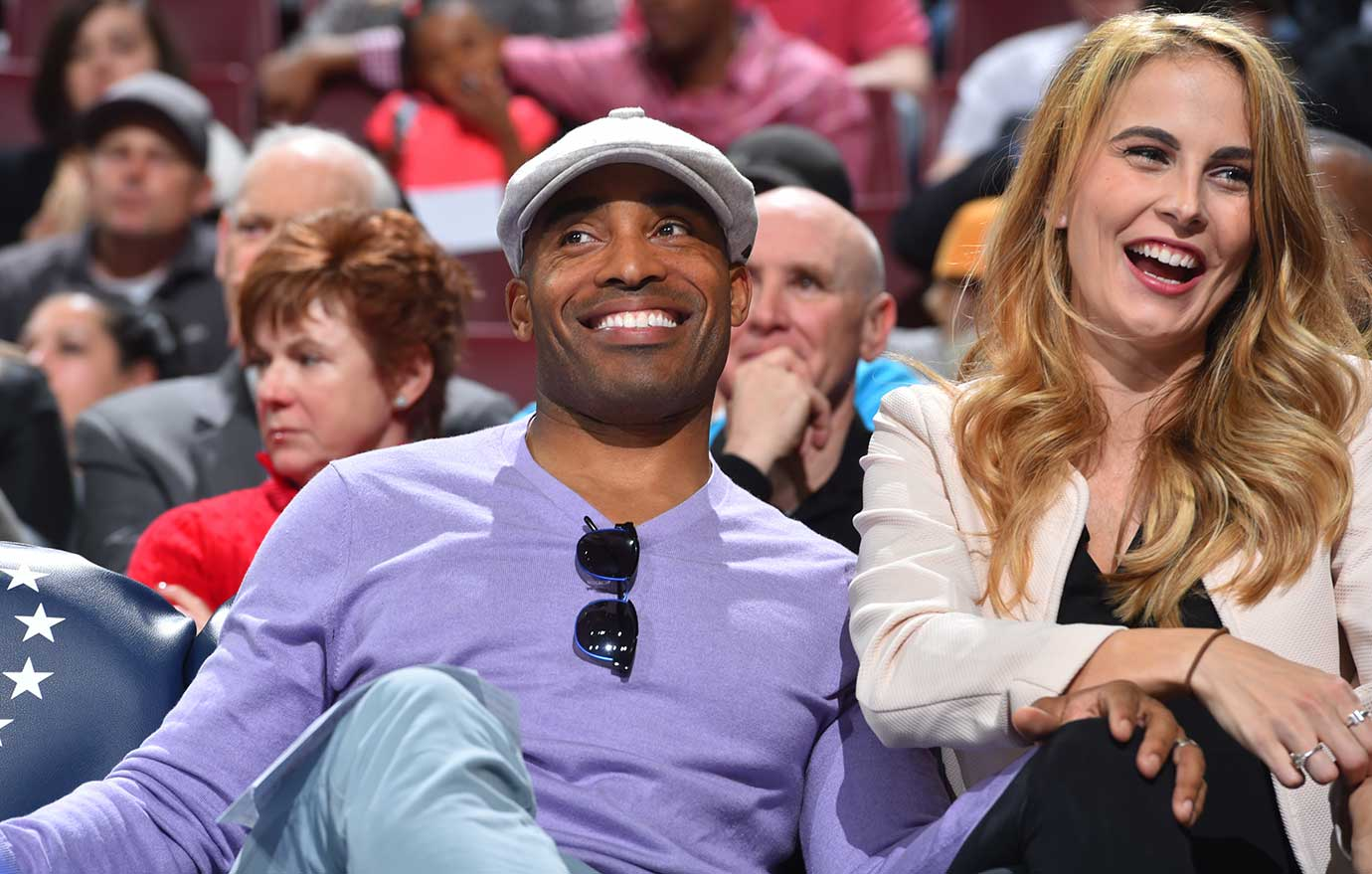 Former New York Giants Tiki Barber watches the Philadelphia 76ers against the Houston Rockets.