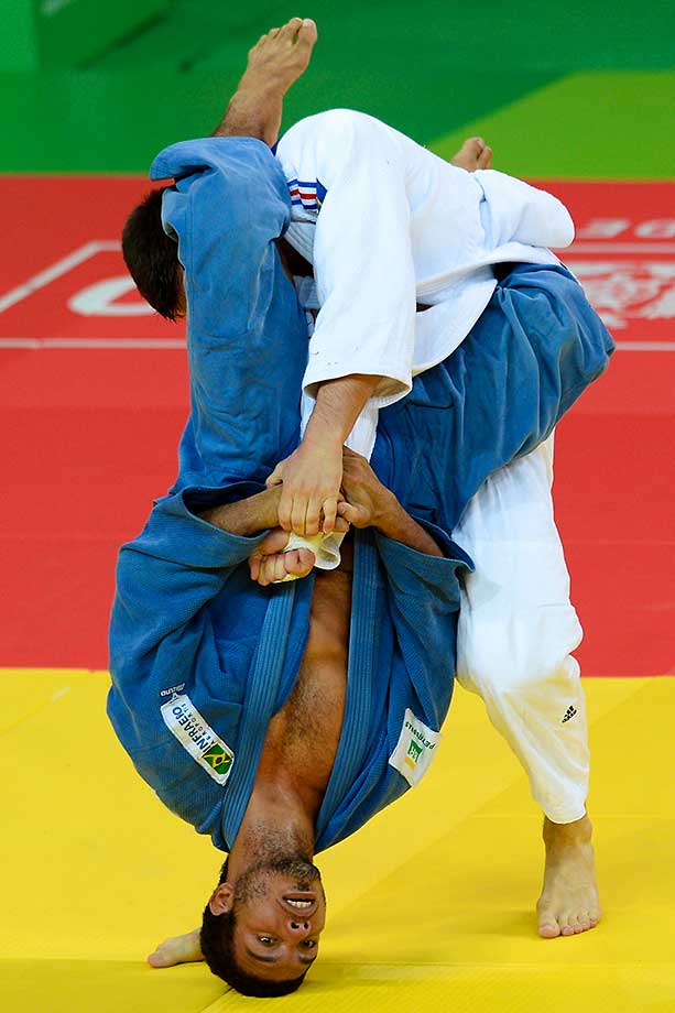 Nicolas Chilard of France puts Igor Pereira of Brazil on his head at the International Judo Tournament in Rio de Janeiro.