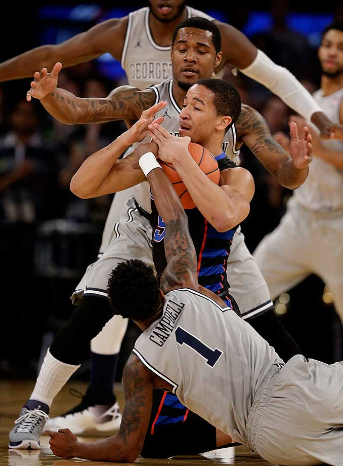 DePaul guard Billy Garrett Jr. calls a timeout as he scrambles for control of the ball against Georgetown's Tre Campbell (1) and D'Vauntes Smith-Rivera.