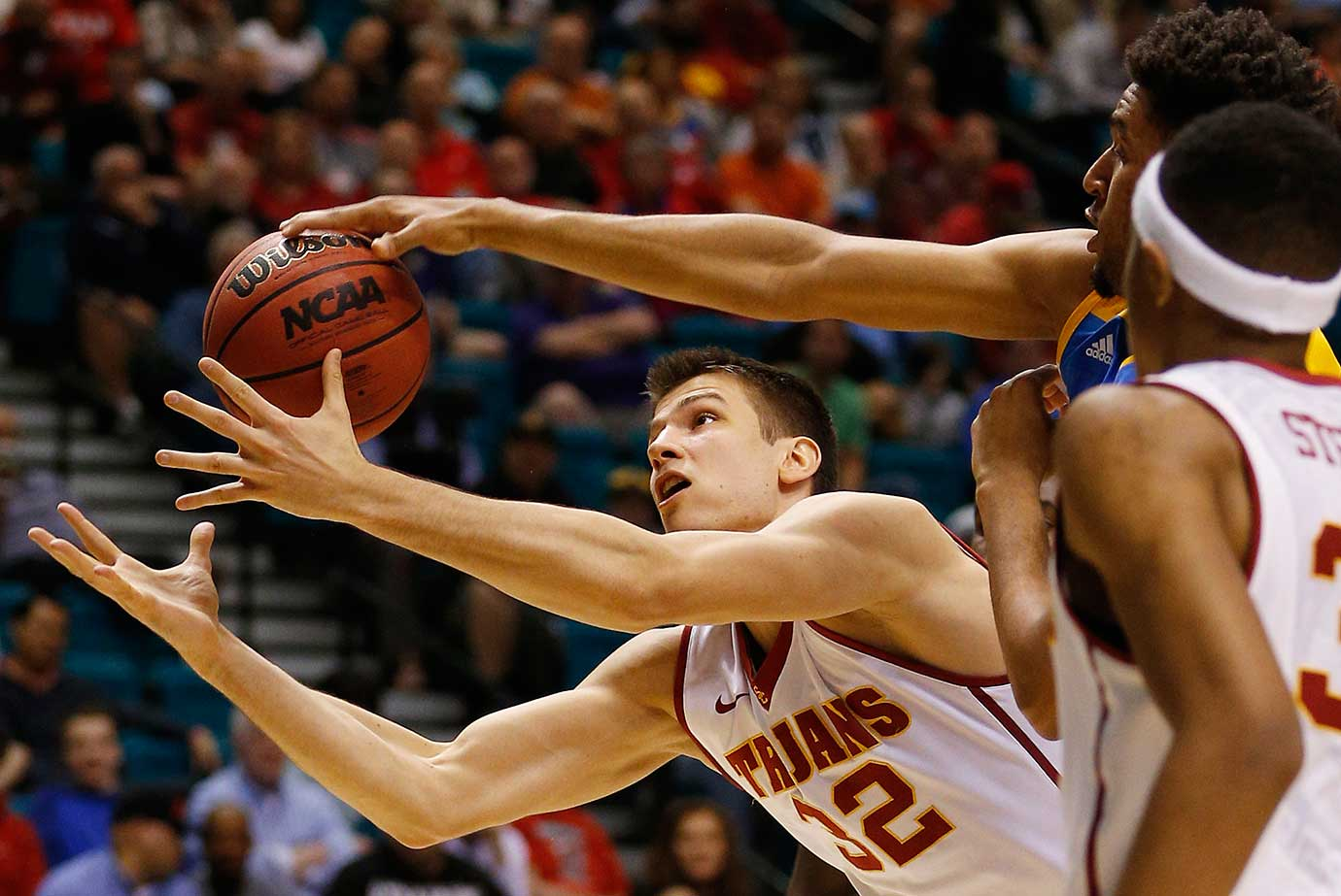 USC forward Nikola Jovanovic reaches for the ball against UCLA in Las Vegas.