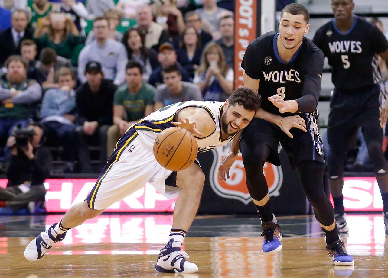 Utah Jazz guard Raul Neto and Minnesota Timberwolves guard Zach LaVine vie for a loose ball in Salt Lake City.