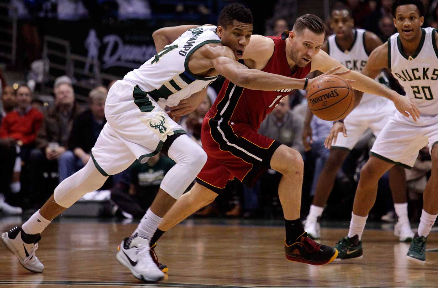 Milwaukee Bucks forward Giannis Antetokounmpo steals the ball from Miami Heat guard Beno Udrih in Milwaukee.