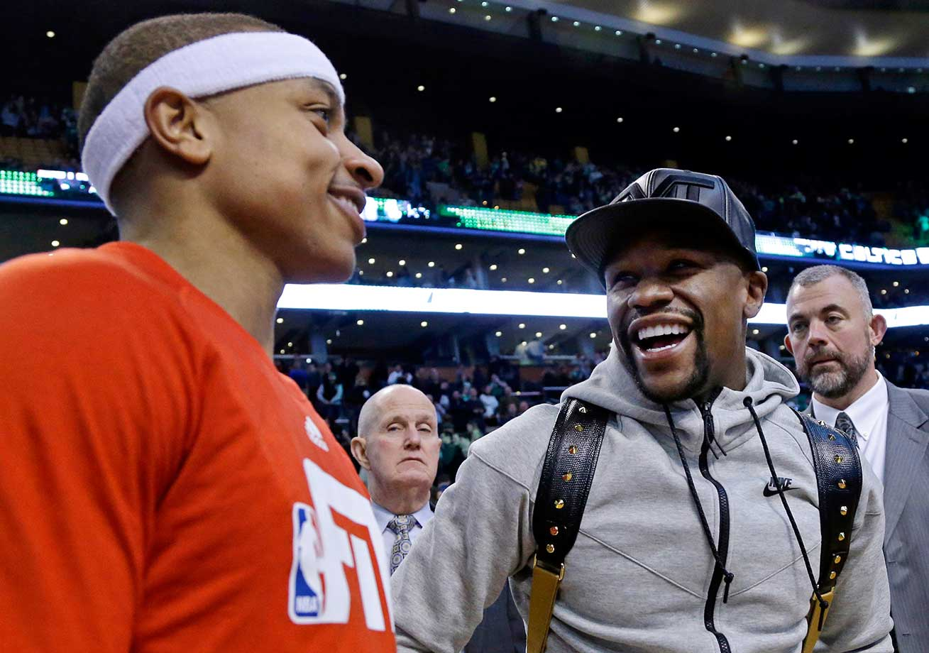Floyd Mayweather, Jr. laughs with Boston Celtics guard Isaiah Thomas after an NBA game between the Celtics and the Orlando Magic in Boston. The Celtics won 113-94.