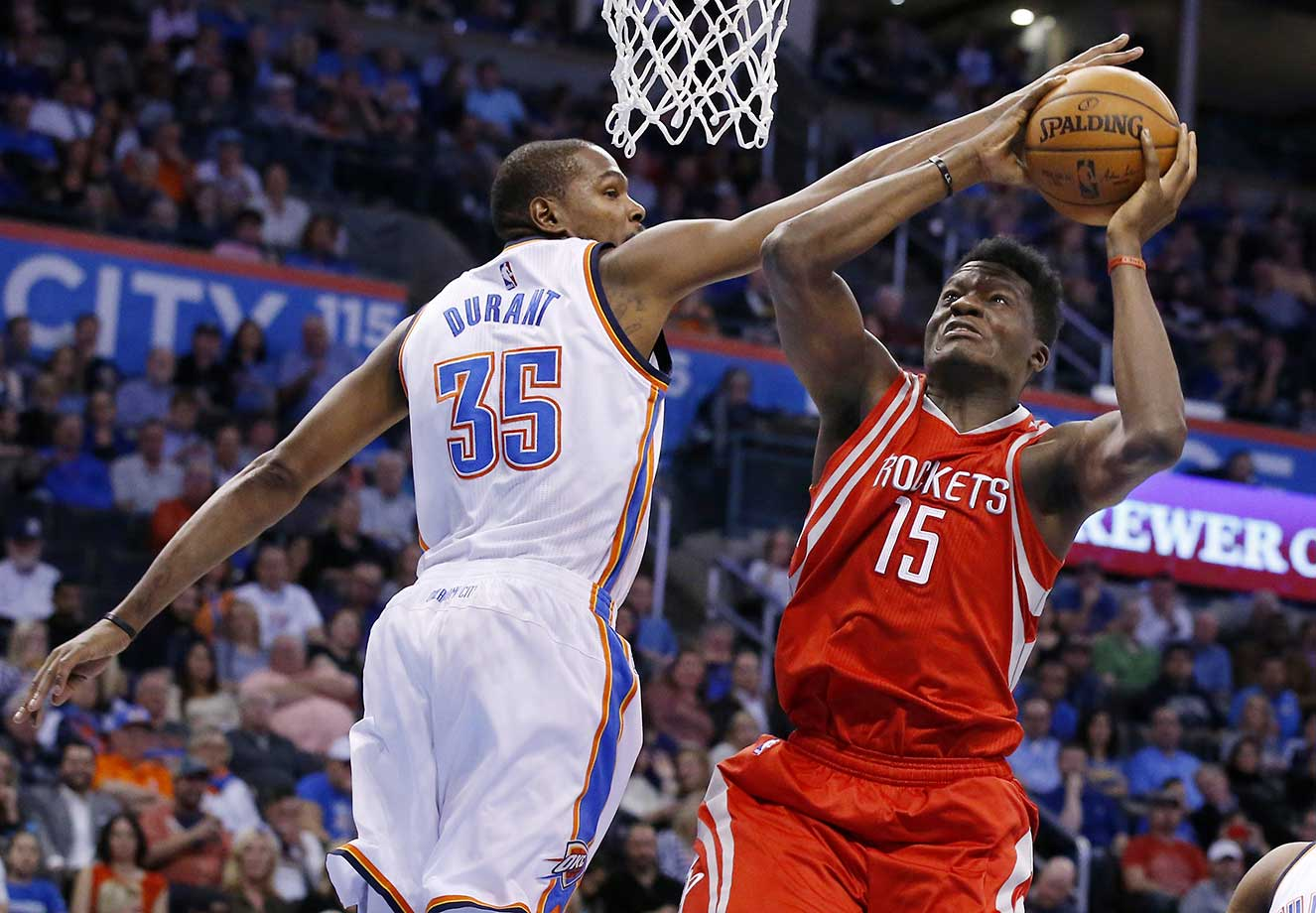 Oklahoma City Thunder forward Kevin Durant defends Houston Rockets forward Clint Capela in Oklahoma City. The Thunder won 116-108.
