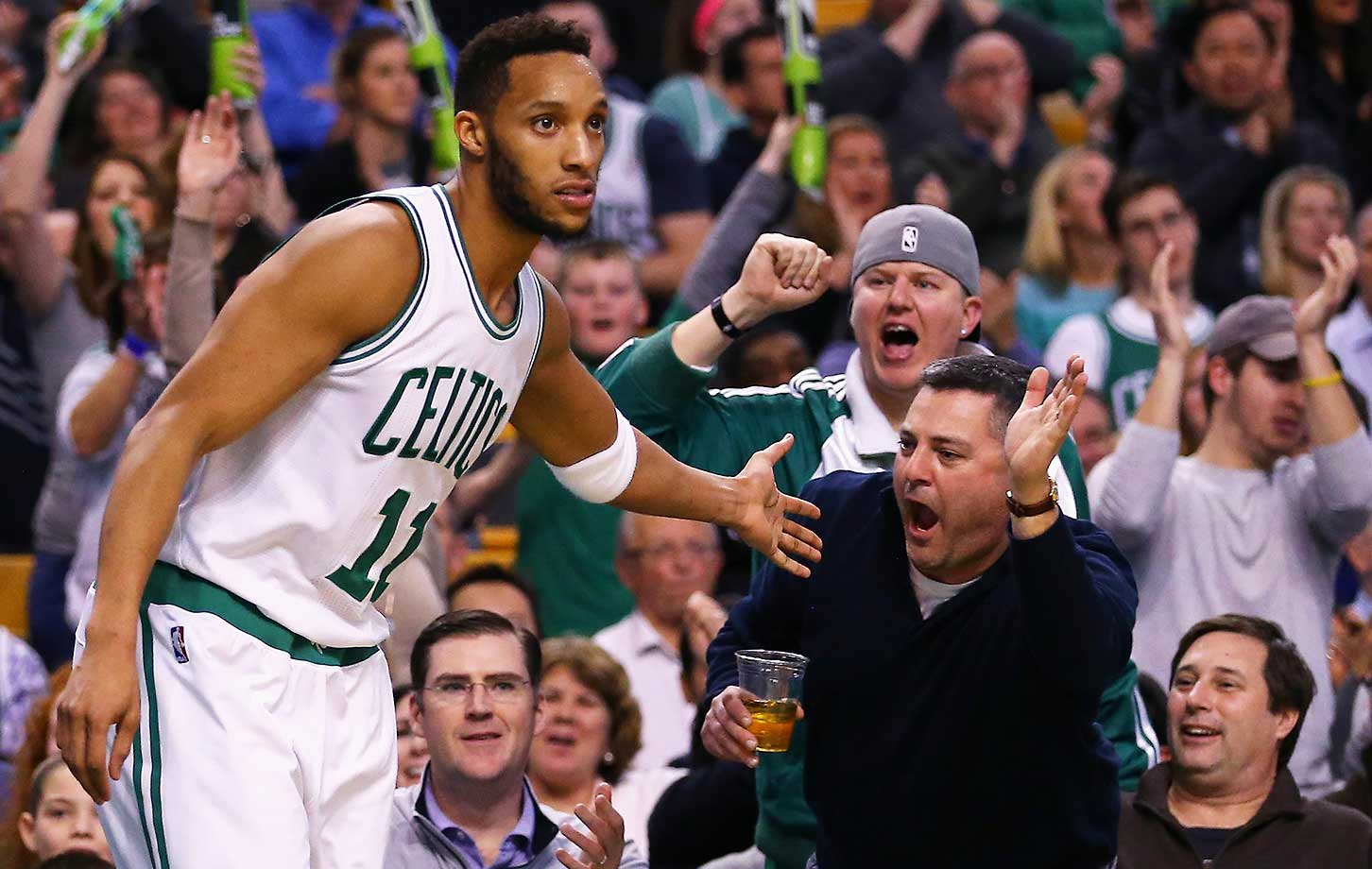 Evan Turner slyly asks for a high-five from a Boston Celtics fan.