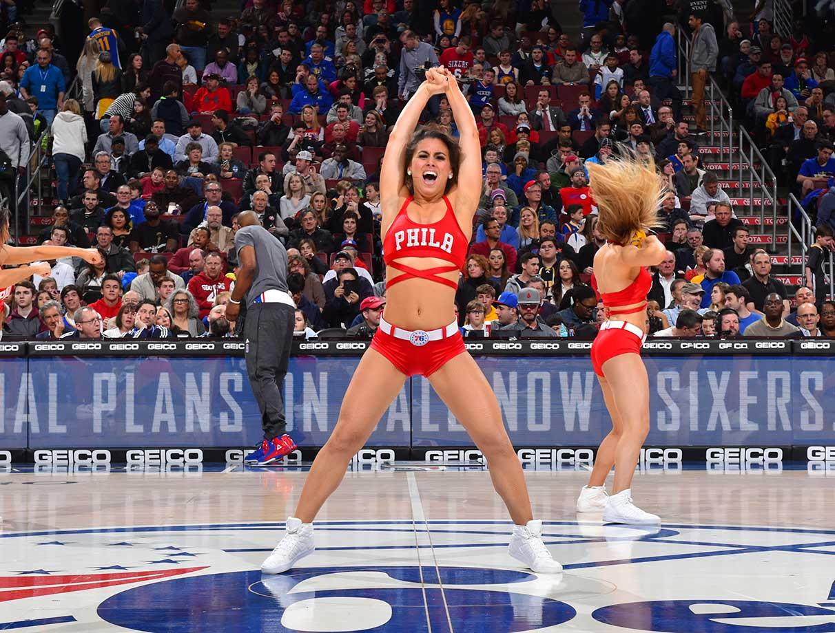 A member of the Philadelphia 76ers dance team performs for the crowd against the Golden State Warriors at Wells Fargo Center in Philadelphia.