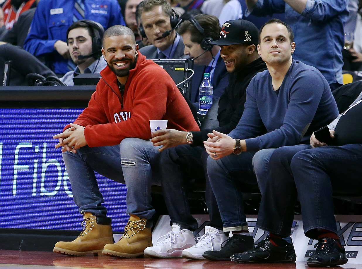 Rapper Drake enjoys the basketball during an NBA game between the Detroit Pistons and the Toronto Raptors at the Air Canada Centre  in Toronto.