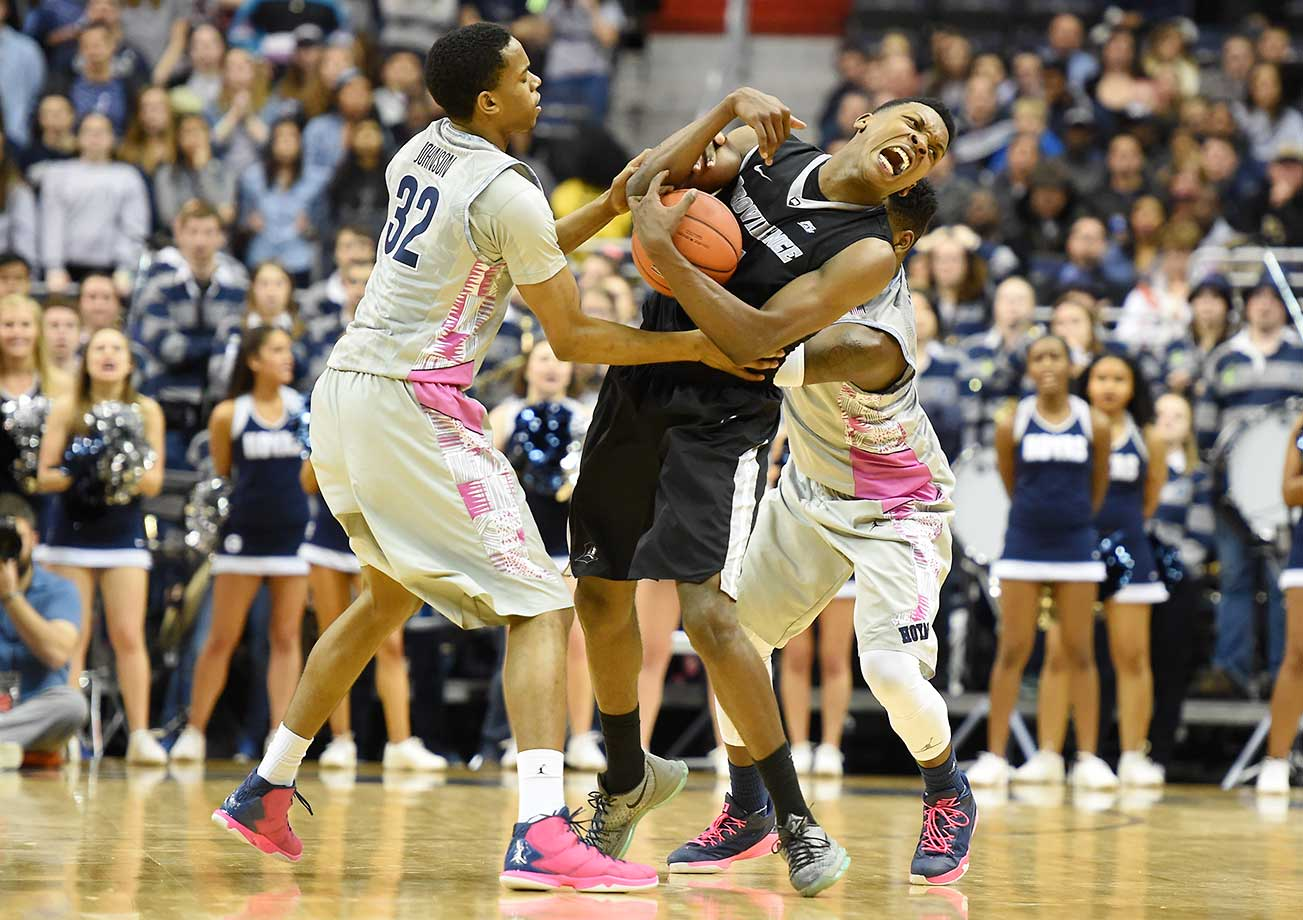 Kaleb Johnson of the Georgetown Hoyas and Rodney Bullock of the Providence Friars fight for a loose ball at the Verizon Center in Washington, D.C.
