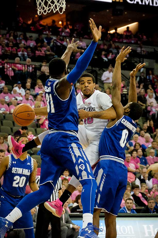 Maurice Watson Jr. of the Creighton Bluejays passes the ball around Angel Delgado 31 and Khadeen Carrington of the Seton Hall Pirates during their game at CenturyLink Center in Omaha, Neb.