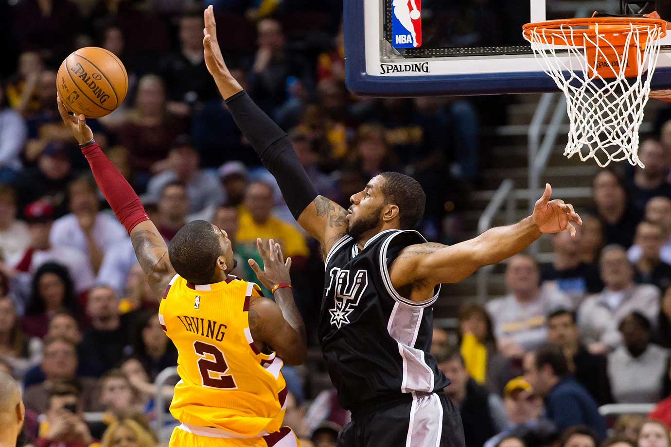 Kyrie Irving of the Cleveland Cavaliers shoots over LaMarcus Aldridge of the San Antonio Spurs at Quicken Loans Arena. The Cavaliers defeated the Spurs 117-103.