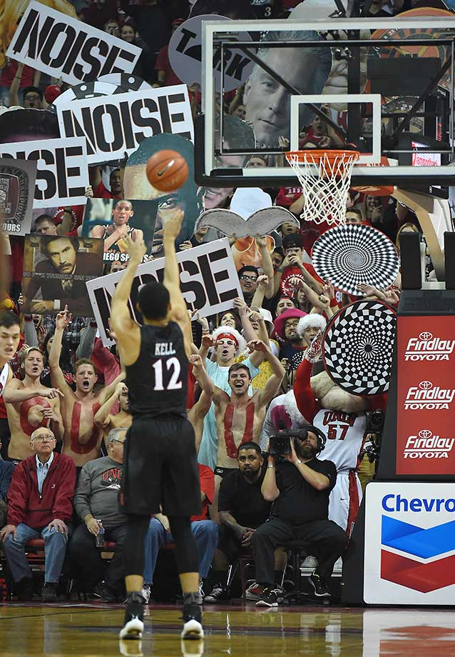 UNLV Rebels fans try to distract Trey Kell of the San Diego State Aztecs as he shoots a free throw during a game at the Thomas & Mack Center in Las Vegas, Nev. San Diego State won 67-52.