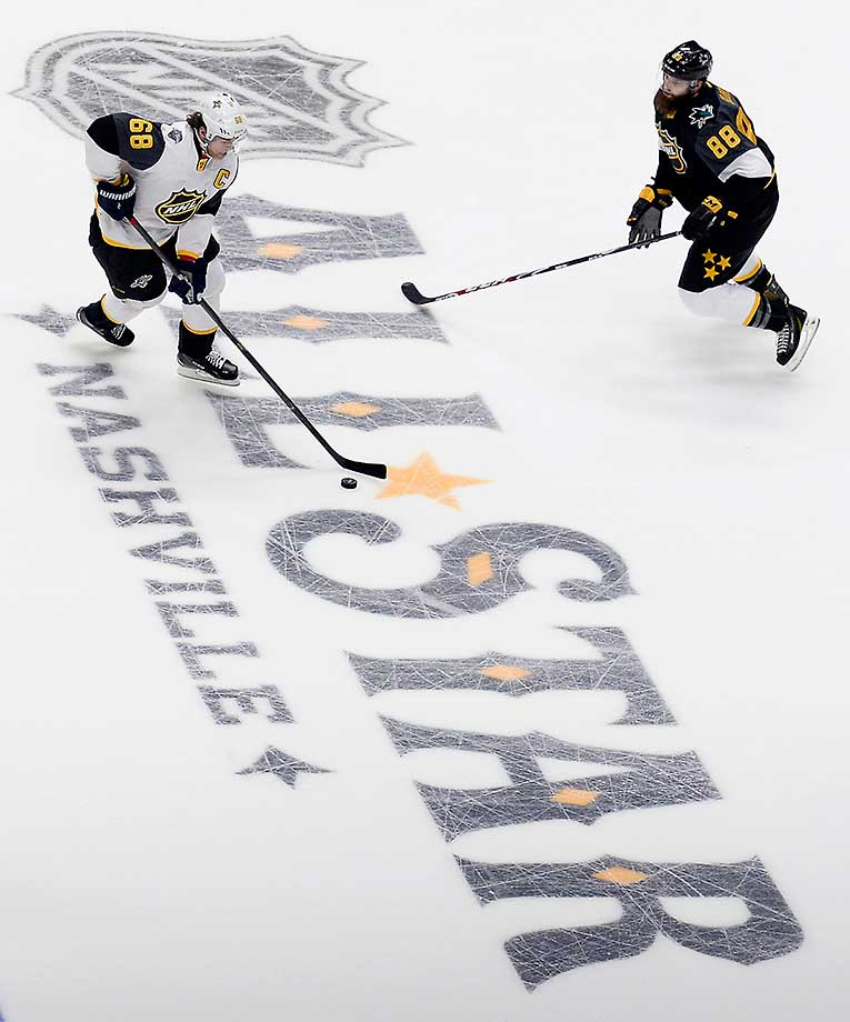 Atlantic Division forward Jaromir Jagr of the Florida Panthers is defended by Pacific Division defenseman Brent Burns of the San Jose Sharks during the NHL All-Star championship game. The Pacific Division won 1-0.