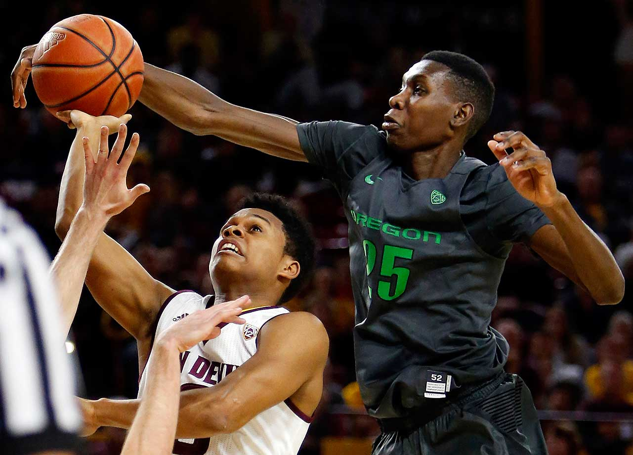 Oregon forward Chris Boucher blocks Arizona State guard Tra Holder shot in Tempe, Ariz. Oregon defeated Arizona State 91-74.