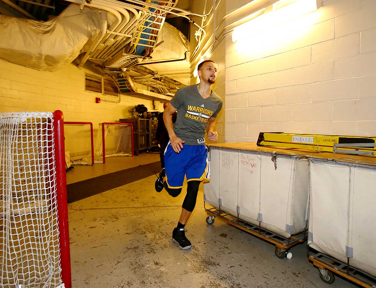 Stephen Curry of the Golden State Warriors warms up before the game against the New York Knicks at Madison Square Garden in New York City.