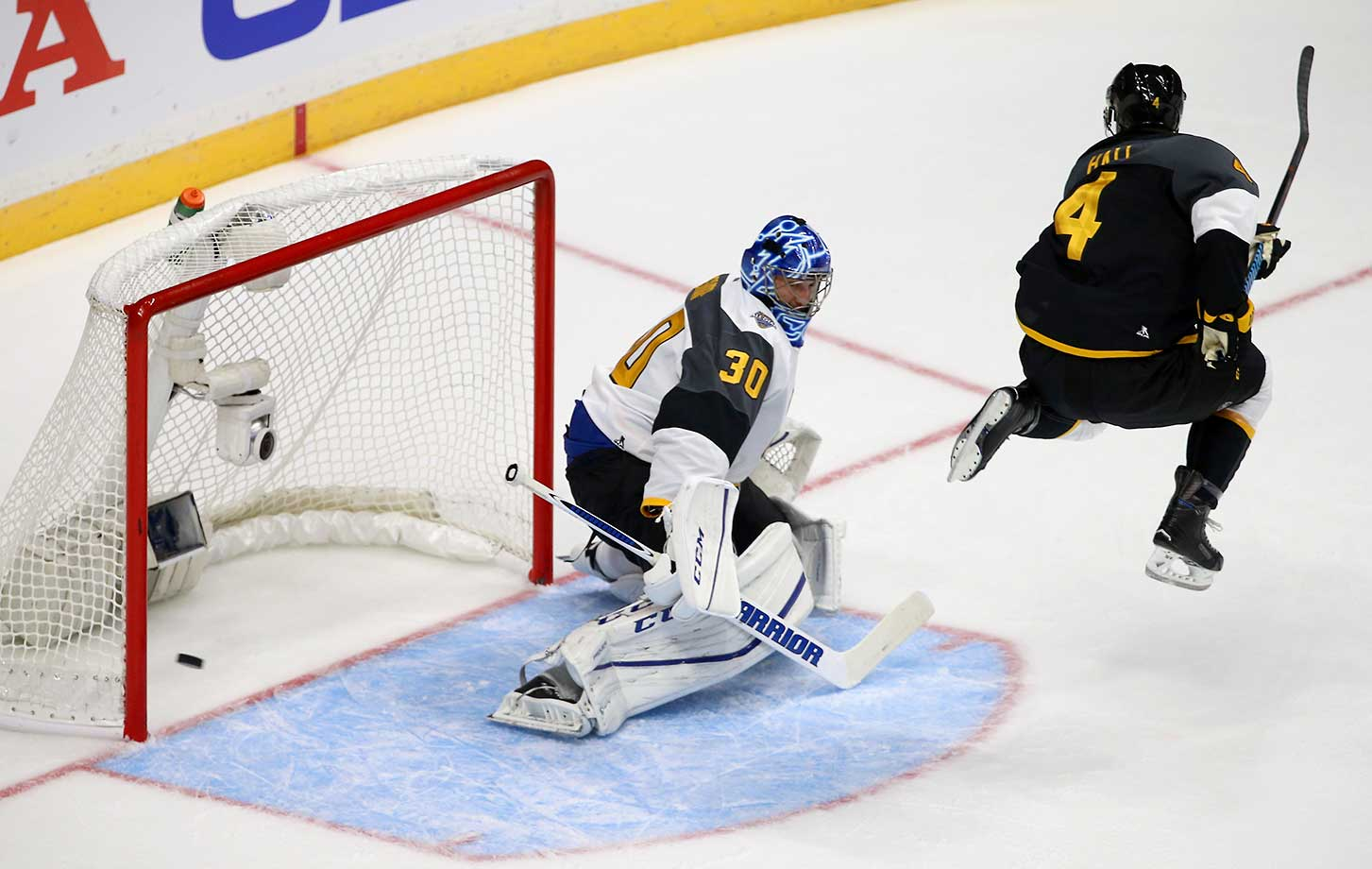 Goaltender Ben Bishop of the Tampa Bay Lightning defends his net against Taylor Hall of the Edmonton Oilers during the 2016 Honda NHL All-Star Final Game between the Eastern and the Western Conference in Nashville, Tenn.