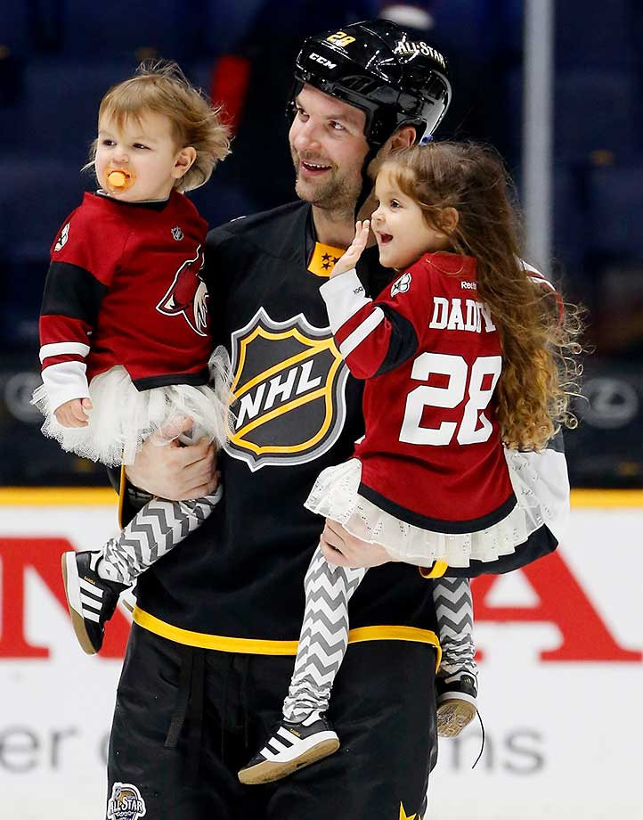 Here are some of the photos that caught our eye during the sports night of Jan. 31, beginning witih John Scott, the 2016 Honda NHL All-Star Game MVP, holding his daughters at Bridgestone Arena in Nashville, Tenn.