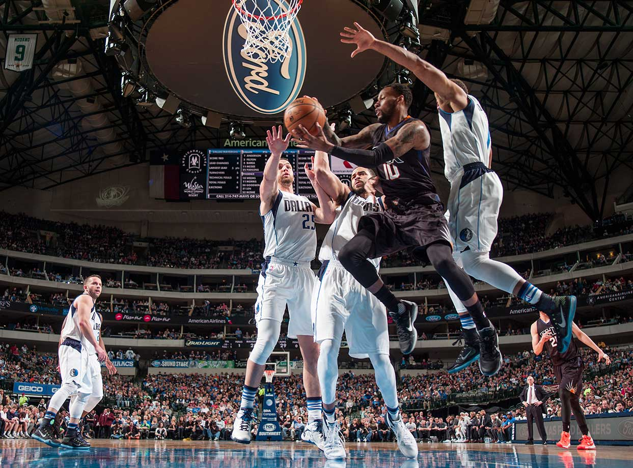 Sonny Weems of the Phoenix Suns looks to pass to a teammate against the Dallas Mavericks  at the American Airlines Center in Dallas.