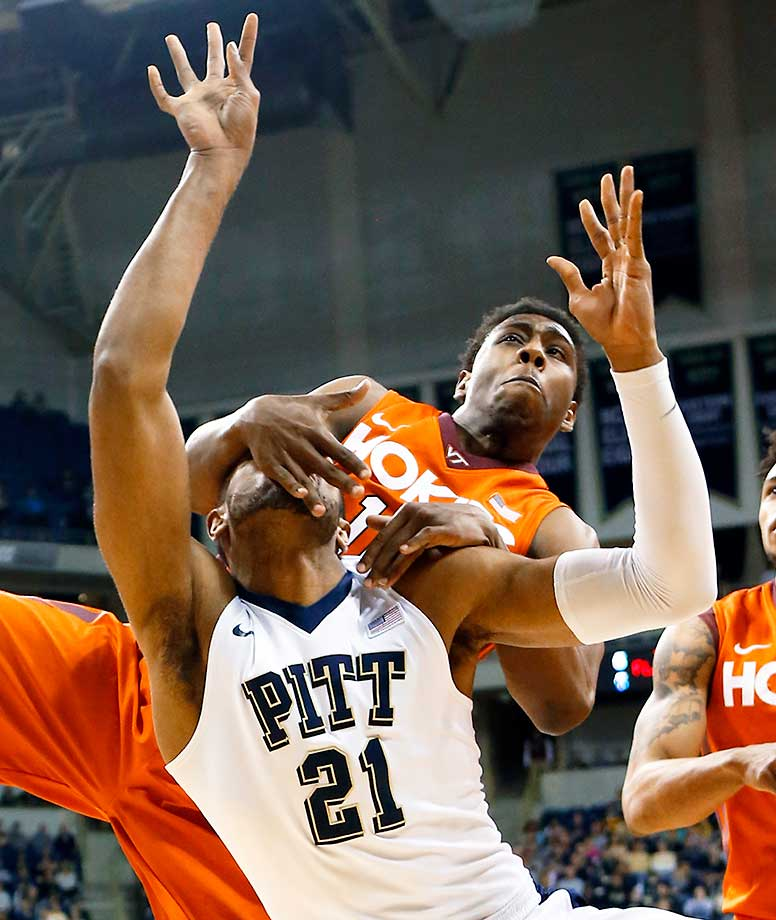 Pittsburgh's Sheldon Jeter is fouled by Virginia Tech's Justin Bibbs in Pittsburgh.