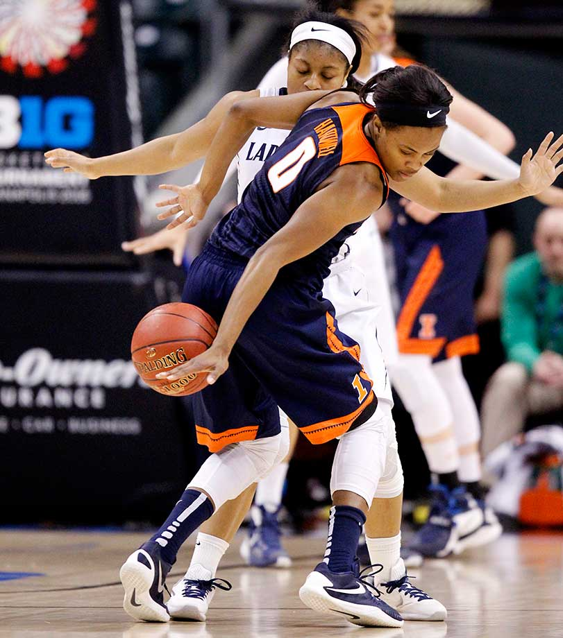 Illinois guard Sarah Hartwell looses control of the ball during a Big Ten Tournament game vs. Penn State.