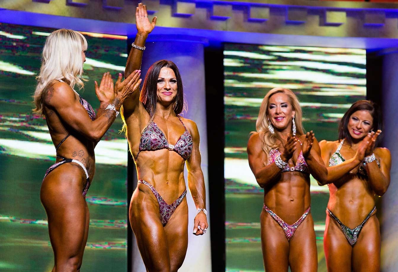 Oksana Grishina waves to the crowd after being announced the winner in Fitness International in Columbus, Ohio.