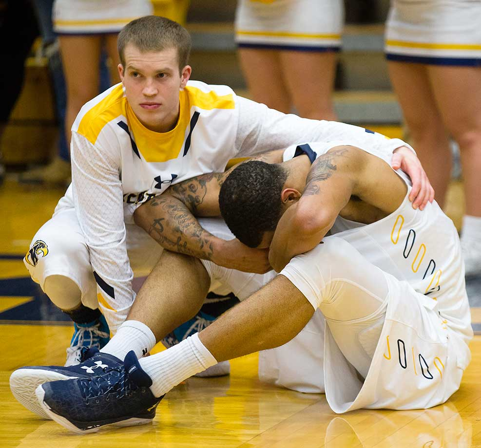 Kent State's Jon Fleming consoles Chris Ortiz after their 70-69 upset loss and elimination by Bowling Green from the MAC Tournament.
