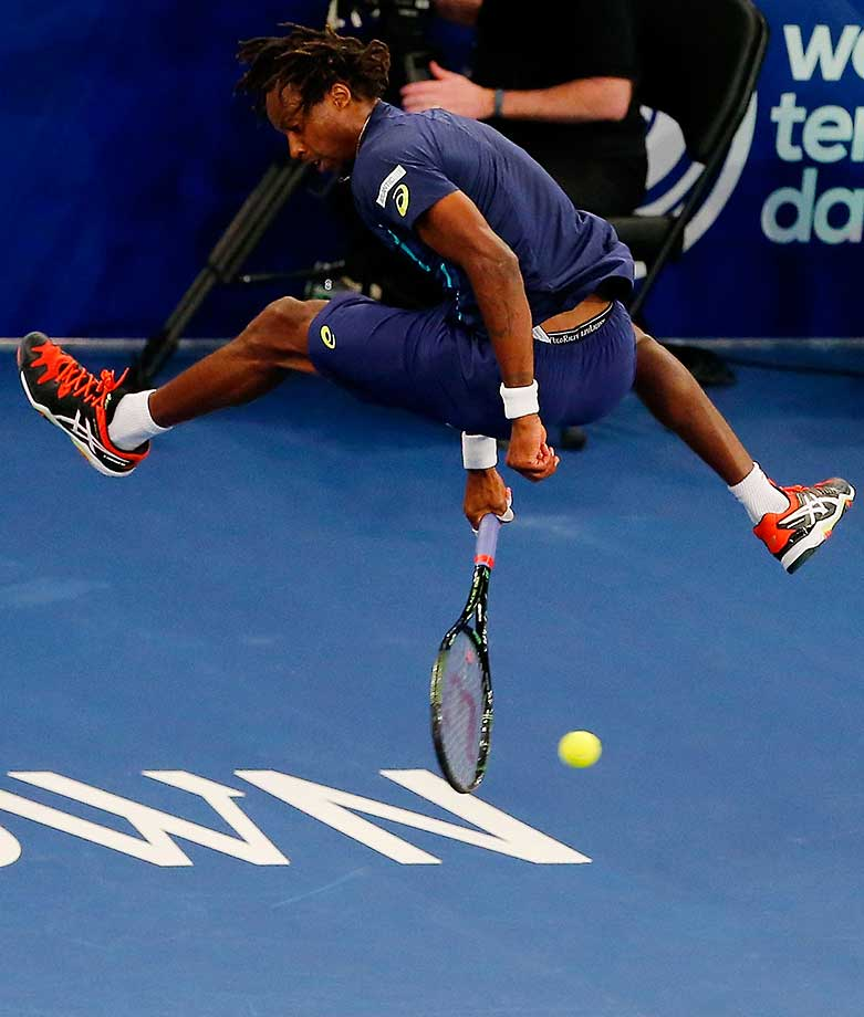 Gael Monfils returns a shot to Stan Wawrinka during their match at the BNP Paribas Showdown at Madison Square Garden.