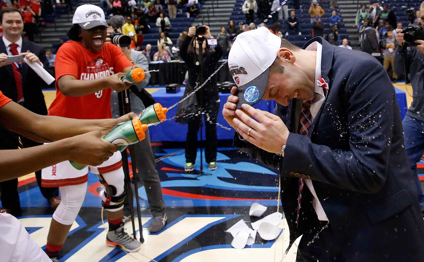 St. John's head coach Joe Tartamella is squirted by his players after winning the Big East Conference tournament.