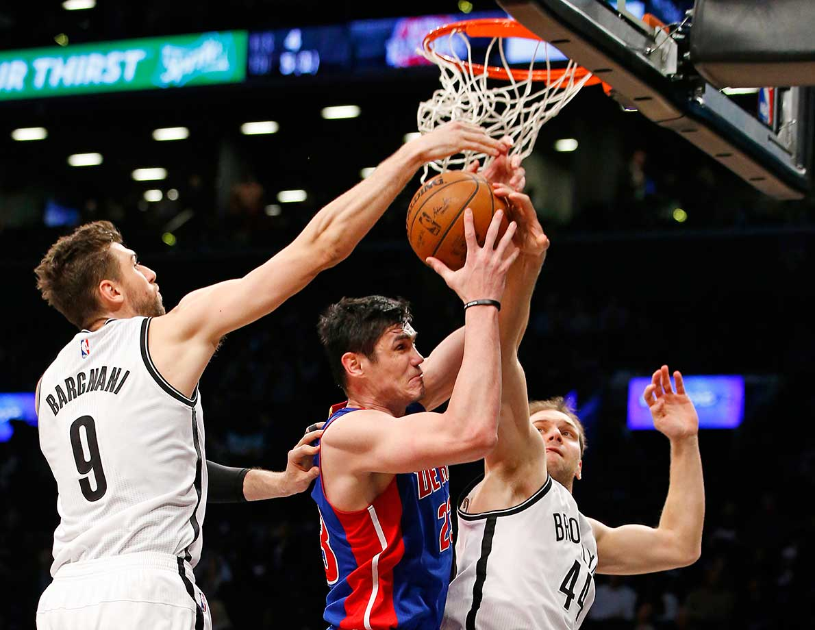 Brooklyn Nets center Andrea Bargnani (9) and Nets guard Bojan Bogdanovic defend Detroit Pistons forward Ersan Ilyasova in New York.