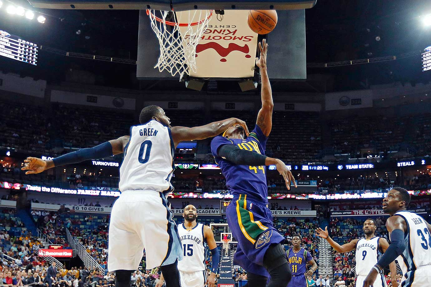 Memphis Grizzlies forward JaMychal Green fouls New Orleans Pelicans forward Dante Cunningham as he drives to the basket in New Orleans.