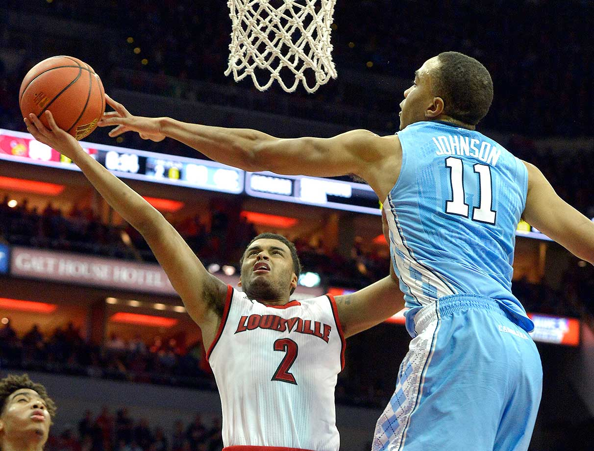 North Carolina's Brice Johnson blocks the shot of Louisville's Quentin Snider. Louisville won 71-65.