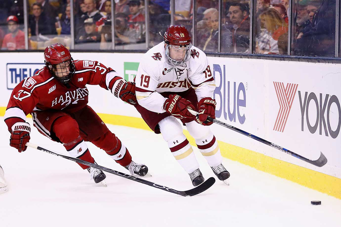 Desmond Bergin of the Harvard Crimson defends Ryan Fitzgerald of the Boston College Eagles at TD Garden in Boston. The Eagles won 3-2.