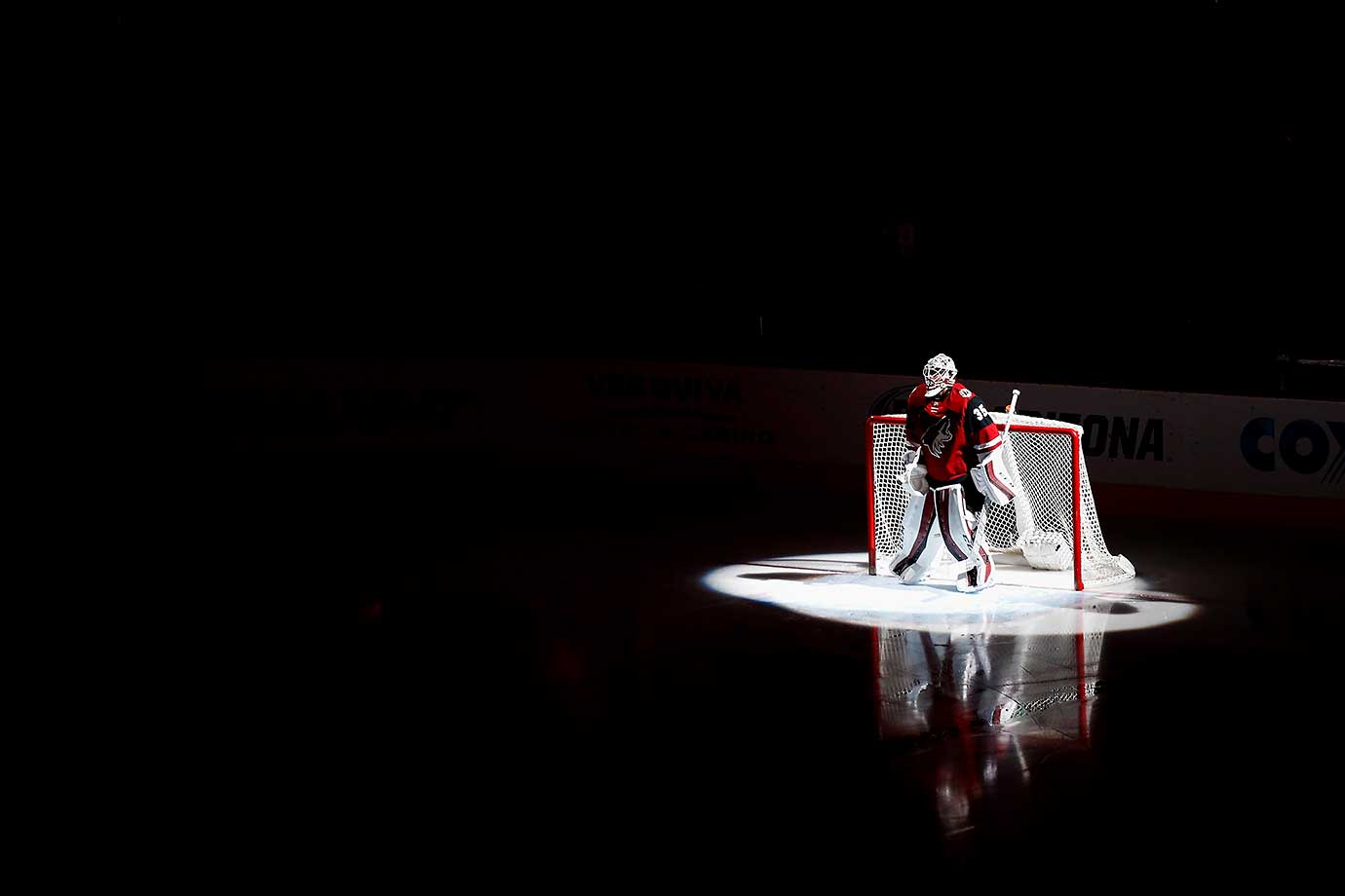 Goaltender Louis Domingue of the Arizona Coyotes is introduced before a game against the Montreal Canadiens.