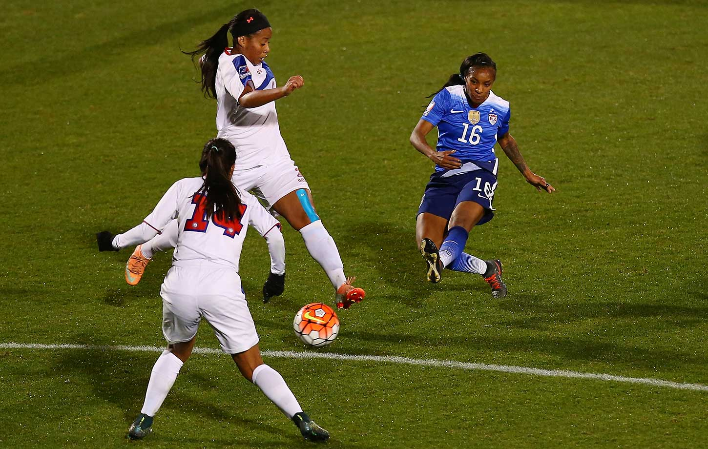 Crystal Dunn of the U.S. scores the third of her national team-record five goals against Puerto Rico during a 10-0 victory in Olympic qualifying.