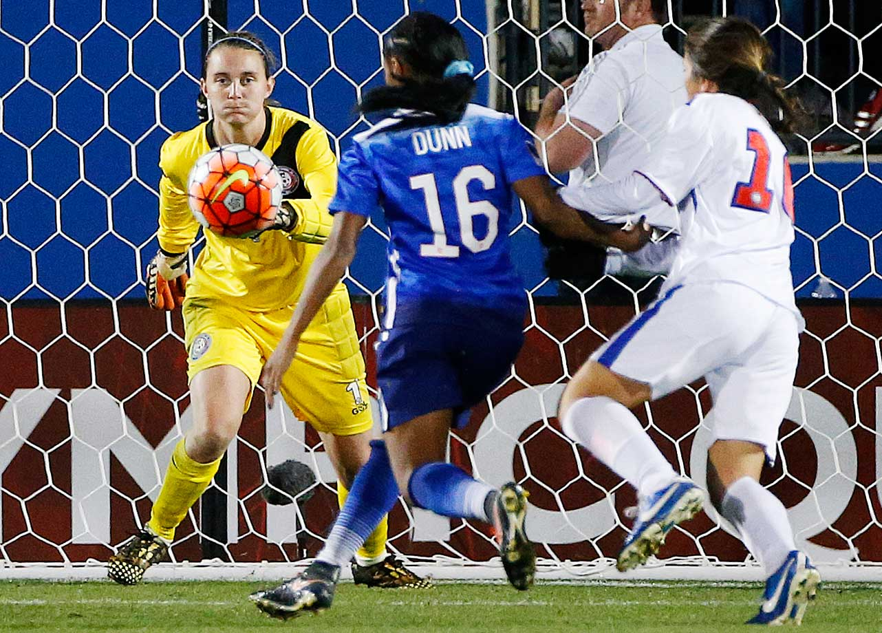 Puerto Rico's Karly Marie Gustafson is unable to stop a goal by Crystal Dunn of the U.S. during an Olympic qualifying match. The U.S. won 10-0.