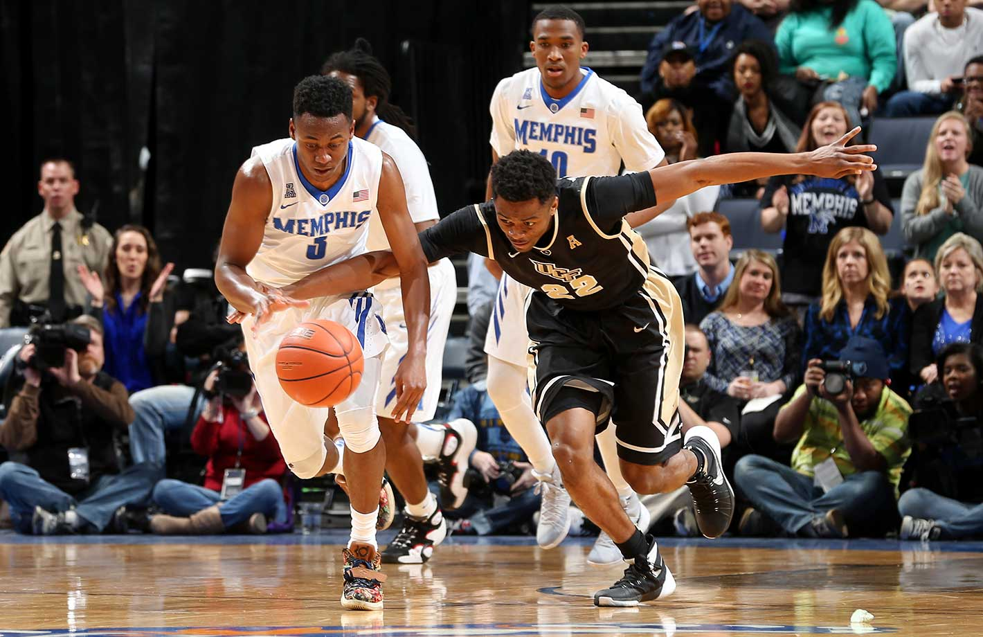Avery Woodson of the Memphis Tigers scrambles for a loose ball against Chanda McSpadden of Central Florida.