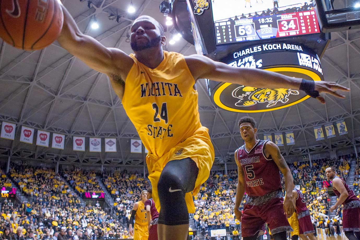 Wichita State's Shaquille Morris attempts to save a ball from going out of bounds during a game against Missouri State.