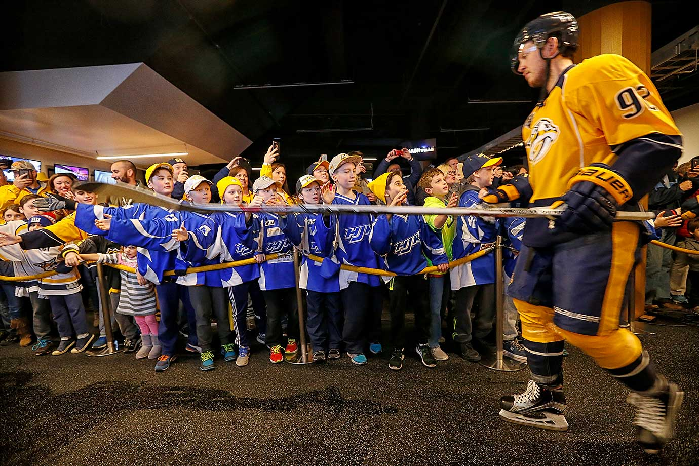 Young fans greet Ryan Johansen of the Nashville Predators as he walks to the ice for a game against Boston.