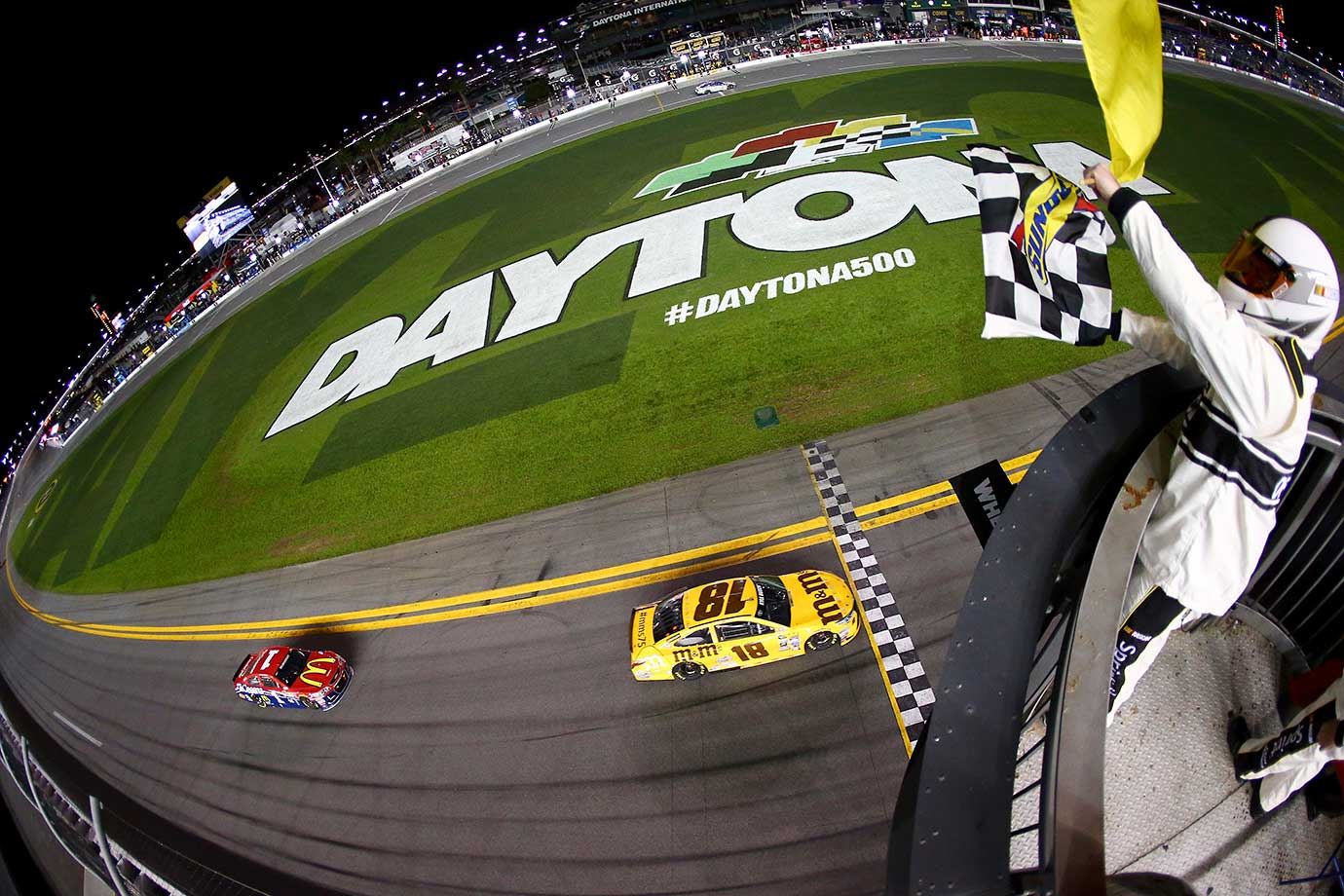 Kyle Busch takes the checkered flag to win a qualifying race that also set the starting grid for Sunday's Daytona 500.