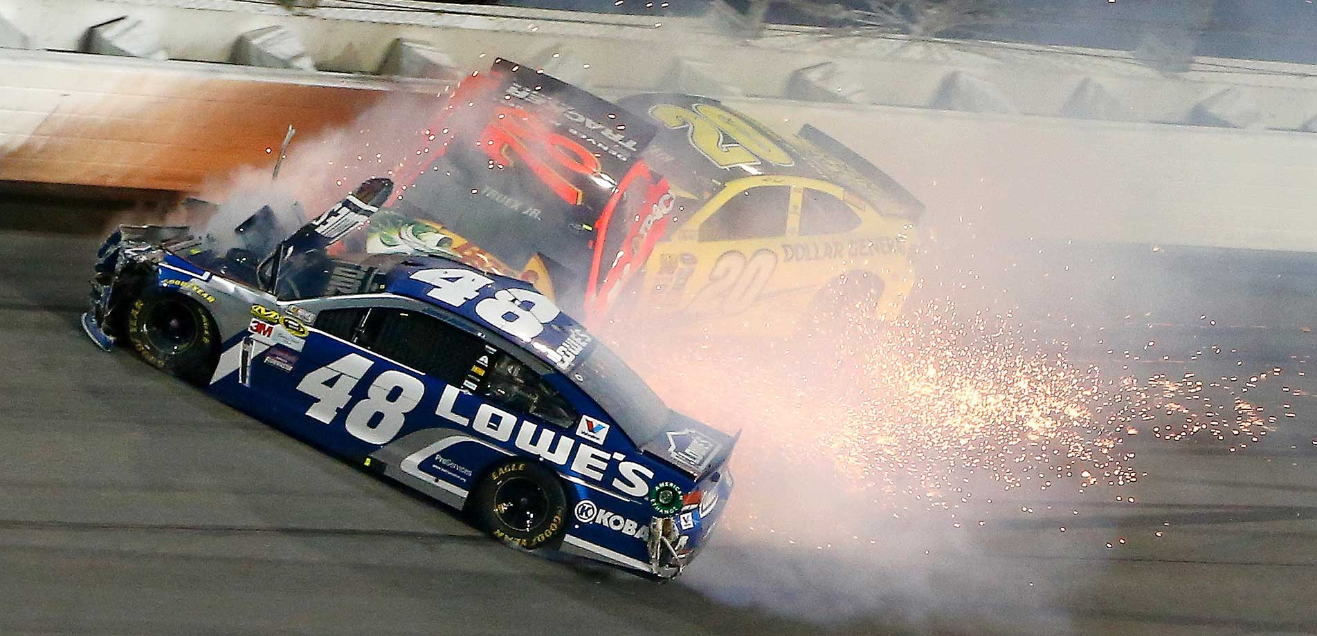 Jimmie Johnson (48), Martin Truex Jr. (78) and Matt Kenseth during an accident in the NASCAR Sprint Cup Series Can-Am Duels at Daytona International Speedway.