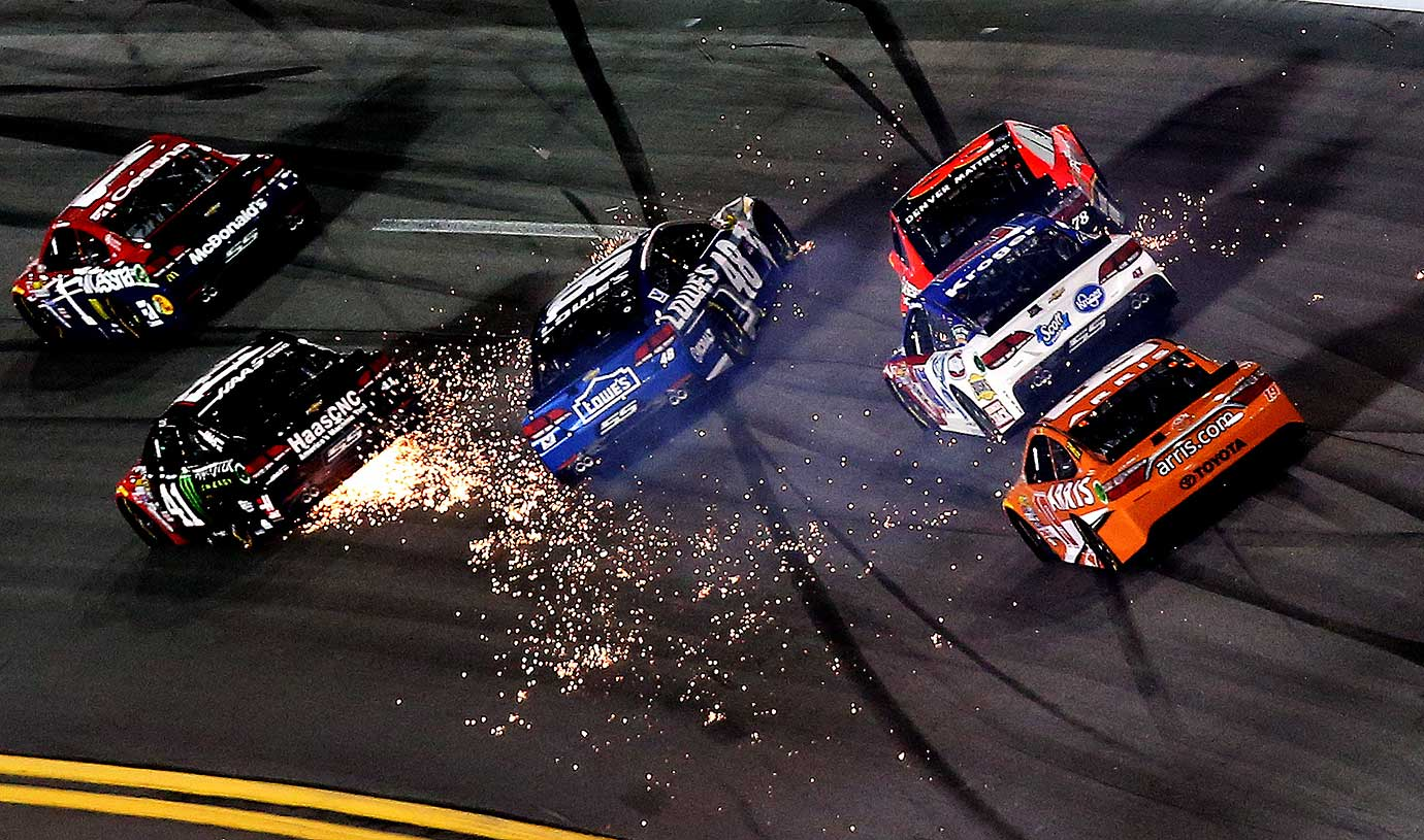Jimmie Johnson, driver of the #48, has an on track incident with Kurt Busch, driver of the #41 at Daytona International Speedway.