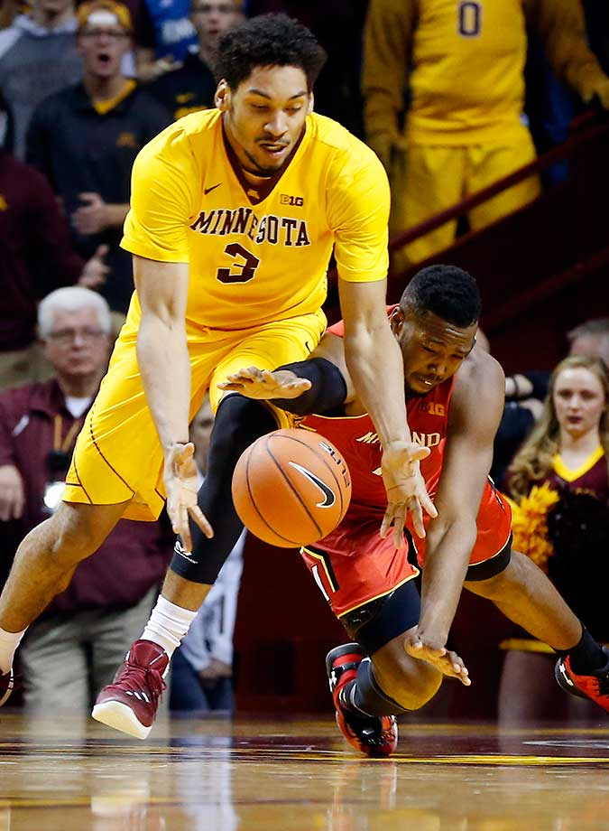 Maryland's Robert Carter falls as he tries to get to the ball along with Minnesota's Jordan Murphy.