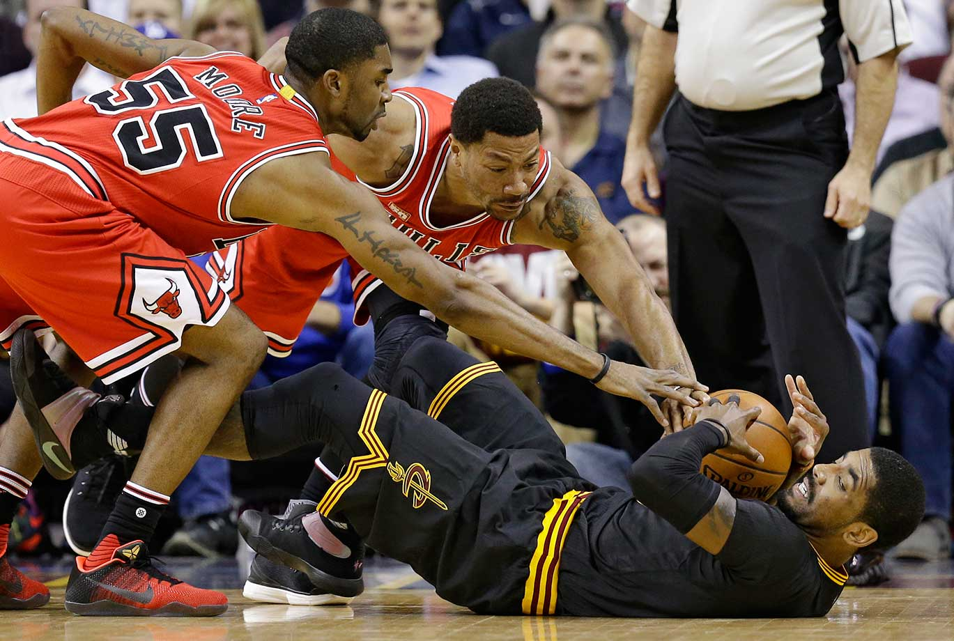 Chicago's E'Twaun Moore, left, and Derrick Rose put pressure on Kyrie Irving of Cleveland.