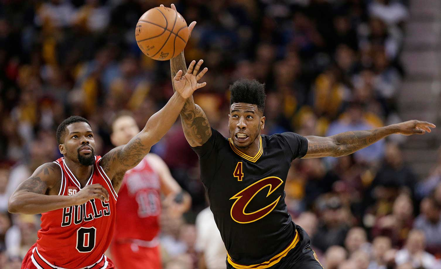 Iman Shumpert of Cleveland and Aaron Brooks of Chicago battle for a loose ball.