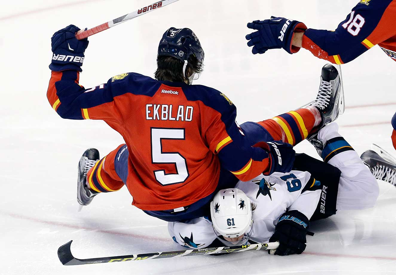 Florida Panthers defenseman Aaron Ekblad falls on San Jose Sharks defenseman Justin Braun.