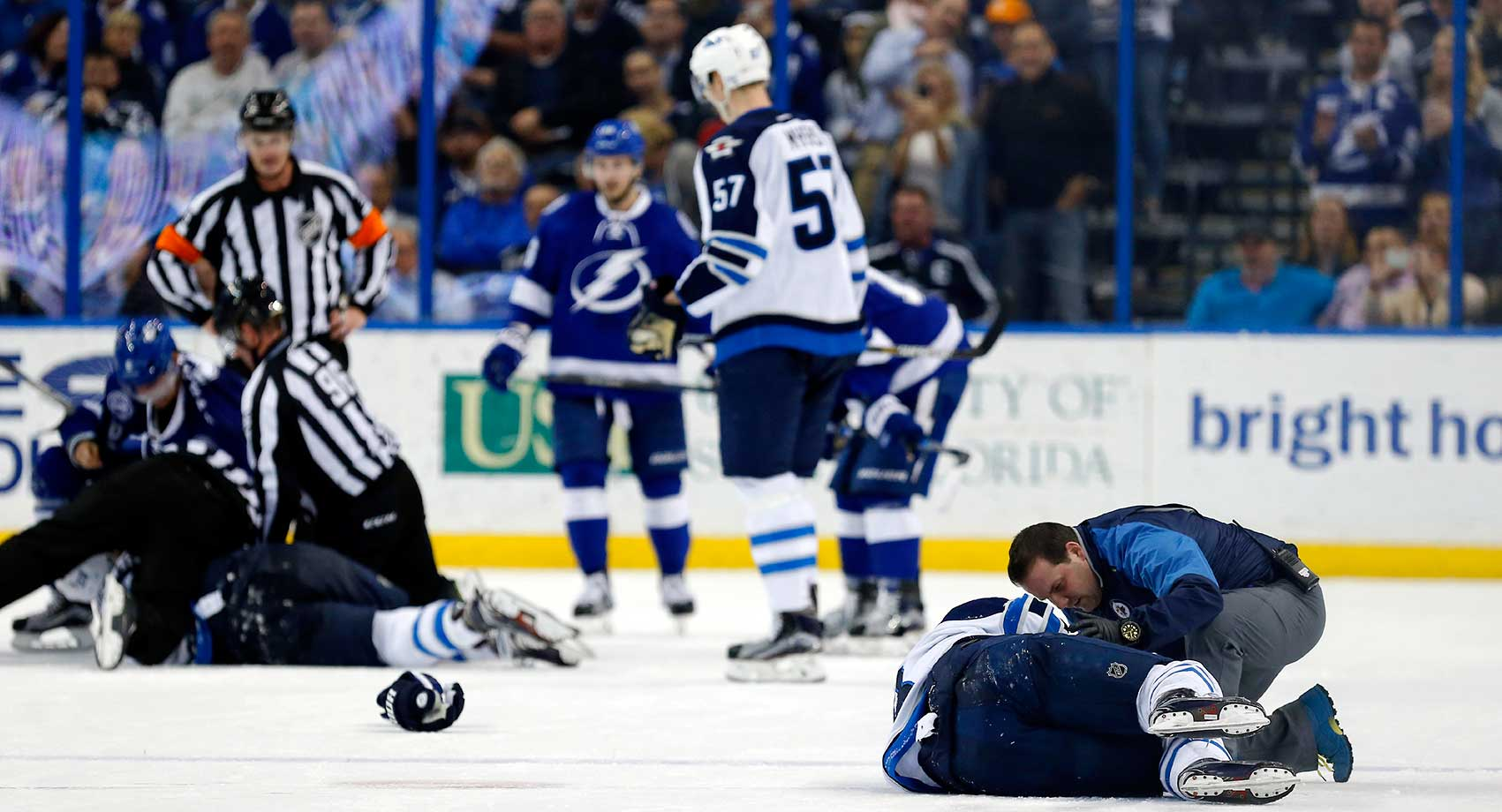 Winnipeg's Bryan Little is attended to after a hit from Tampa Bay's Anton Stralman.