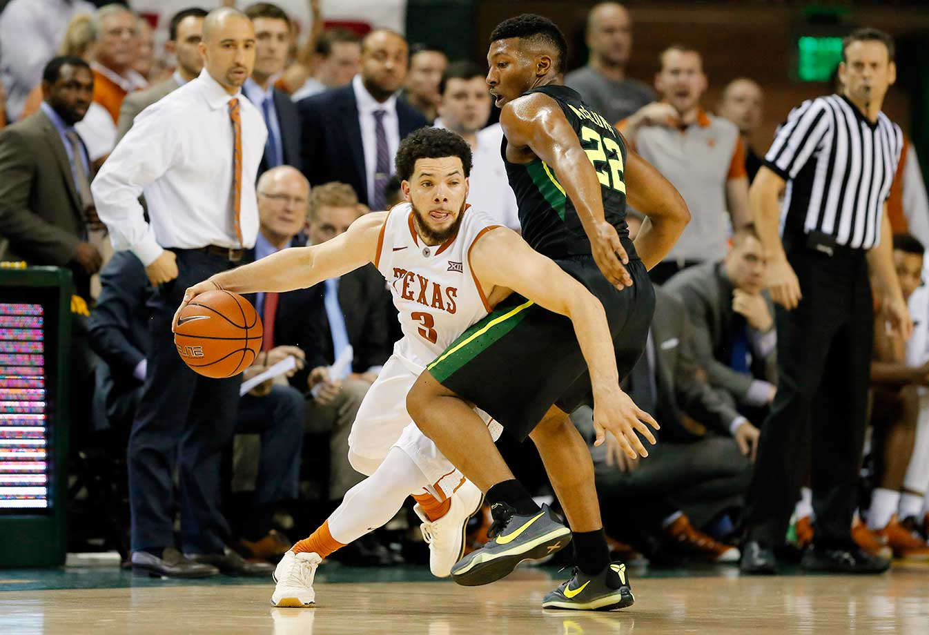 Texas guard Javan Felix drives around Baylor's King McClure in Waco. Texas won 67-59.