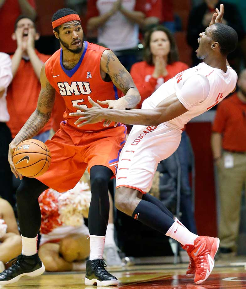 SMU's Markus Kennedy pushes down Houston's Bertrand Nkali for an offensive foul in Houston.