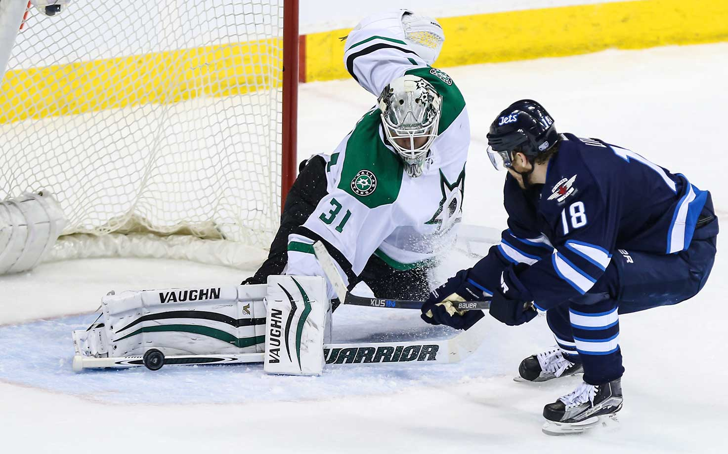 Antti Niemi of the Dallas Stars stops Bryan Little of Winnipeg at the MTS Centre in Winnipeg.