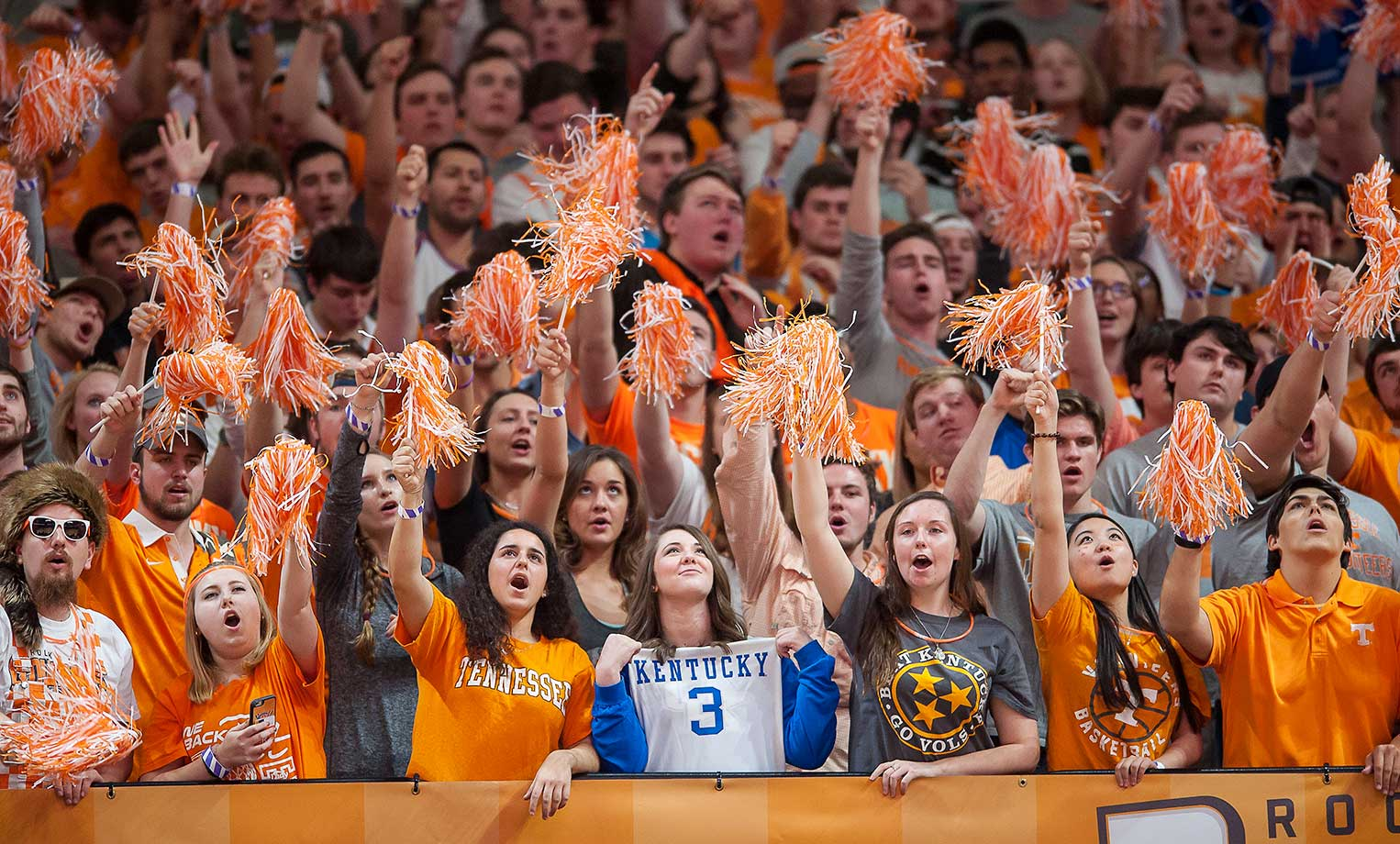 A lone Kentucky fan sits among Tennessee Volunteers fans as they erupt during a Tennessee comeback at Thompson-Boling Arena in Knoxville.  Tennessee defeated the Wildcats 84-77.