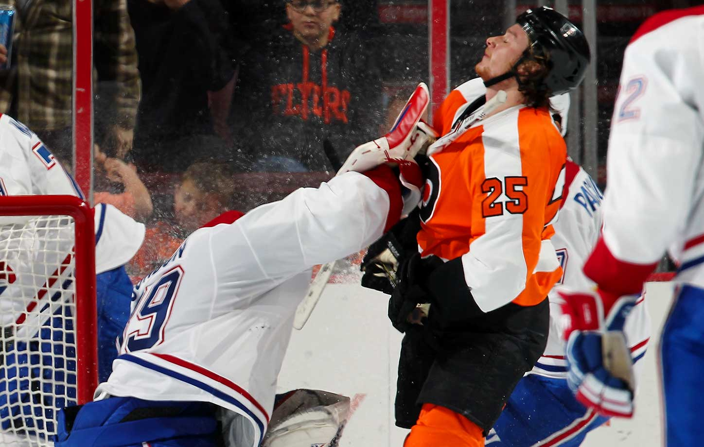 Mike Condon of the Montreal Canadiens checks Ryan White of the Philadelphia Flyers after a stoppage in play at the Wells Fargo Center in Philadelphia.